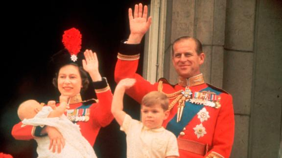The Queen and Prince Philip, accompanied by sons Prince Andrew and Prince Edward, wave from a Buckingham Palace balcony during a parade in June 1964.