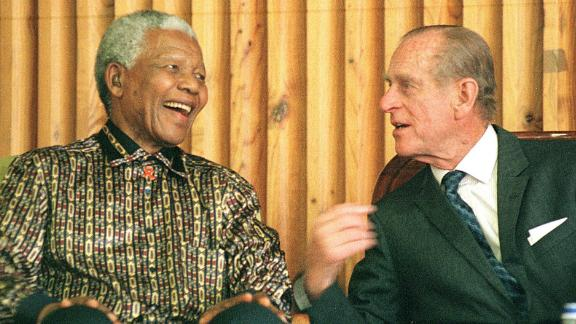Former South African President Nelson Mandela chats with Prince Philip in November 2000.