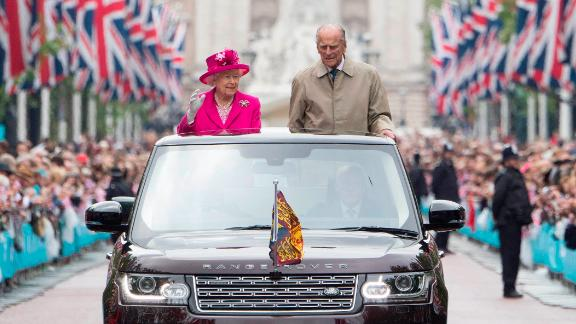 The Queen and Prince Philip wave to guests in June 2016, during celebrations for her 90th birthday.