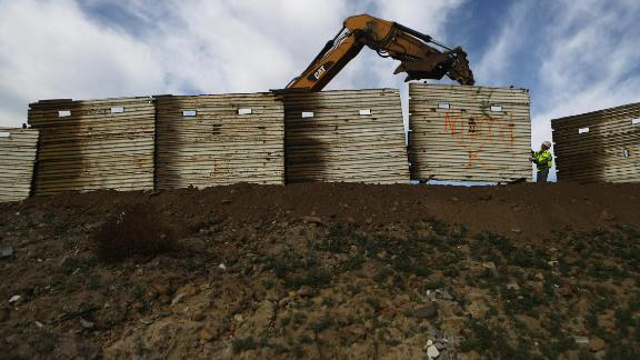 A construction crew works to replace an old section of the U.S.-Mexico border fence on January 11, 2019, as seen from Tijuana, Mexico.