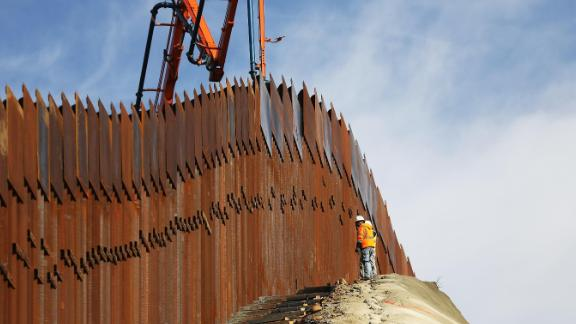 TIJUANA, MEXICO - JANUARY 11: A construction crew works as new sections of the U.S.-Mexico border barrier are installed on January 11, 2019 as seen from Tijuana, Mexico.  President Donald Trump is holding off from a threatened national emergency declaration to fund a border wall amidst the partial government shutdown.  (Photo by Mario Tama/Getty Images)