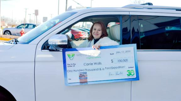 Carrie Walls picked up her check and the keys to her new SUV on Friday in Sterling, Virginia.