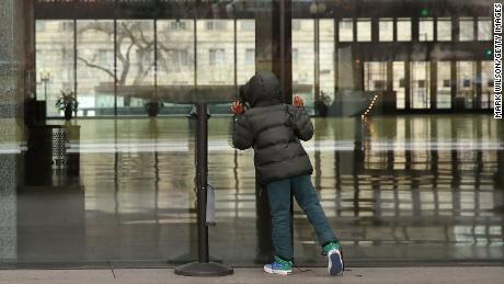 A young tourist looks inside the National Museum of African American History that is closed due to the partial government shutdown.