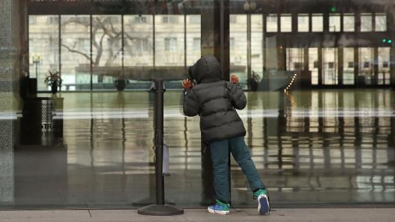 A boy looks inside the National Museum of African American History and Culture, which is closed during the partial government shutdown.