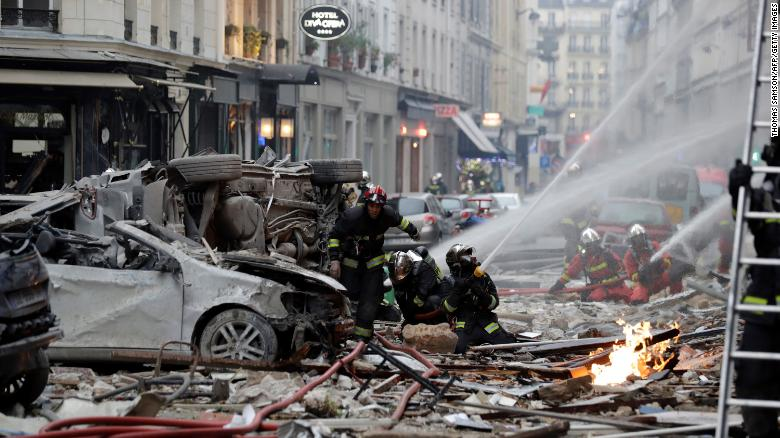 Firefighters intervene after the explosion of a bakery on the corner of the streets Saint-Cecile and Rue de Trevise in central Paris on January 12, 2019.
