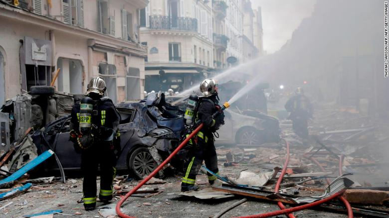 Firefighters intervene after the explosion.