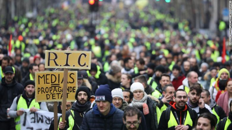 Gilets jaunes protesters march through Paris on Saturday.