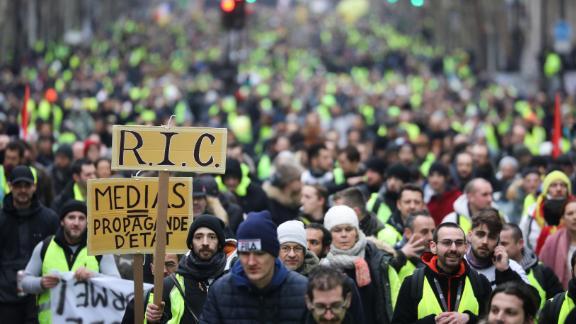 Gilets jaunes protesters march through Paris on Saturday.