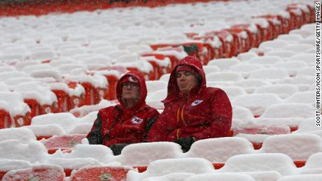 From snowballs to footballs, Kansas City Chiefs fans cheer on their team in the cold
