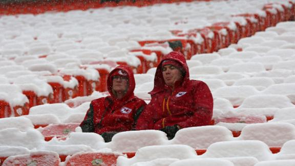 Fans sit in the cold and snow before the Kansas City Chiefs face the Indianapolis Colts on Saturday at Arrowhead Stadium.