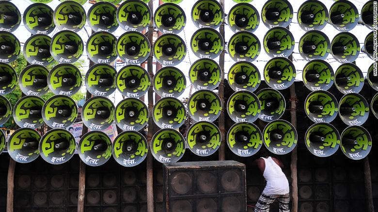 An Indian electrician arranges loudspeakers during a music festival in the city of Prayagraj.