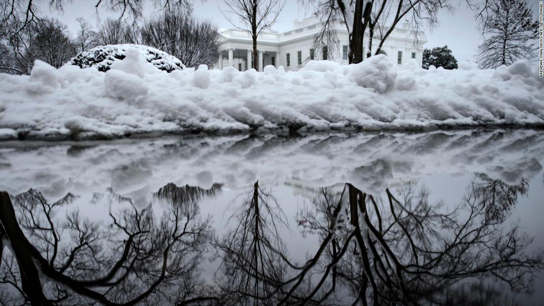 The view of the White House is obscured by a bank of snow.