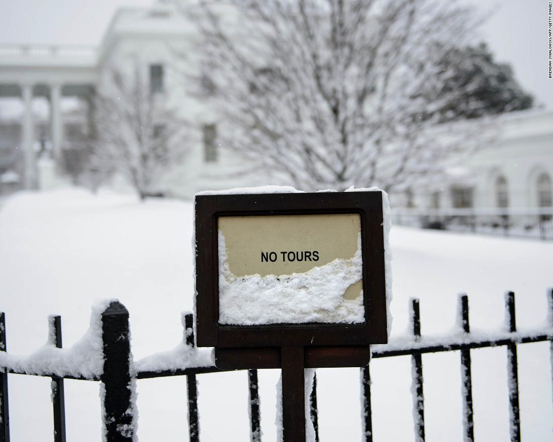 The White House looks especially wintry after a storm on Sunday, January 13.