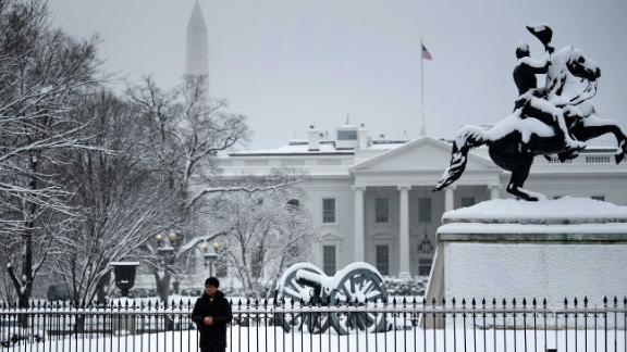 A tourist poses for a photo in Lafayette Square near the White House during a winter storm on the 23rd day of the US government shutdown January 13, 2019 in Washington, DC. - Washington area residents woke up to a winter wonderland, and may need to shovel aside several inches of snow that fell overnight as a winter storm warning remains in effect until 6 p.m. Sunday and more snow is expected to fall. (Photo by Brendan Smialowski / AFP)        (Photo credit should read BRENDAN SMIALOWSKI/AFP/Getty Images)