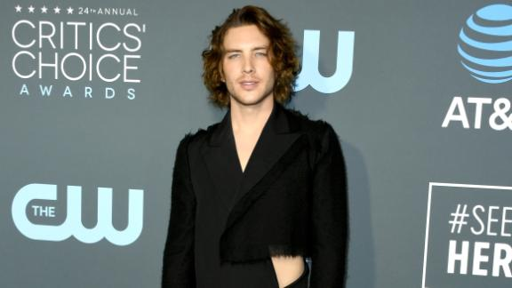 """Cody Fern's dark Yohji Yamamoto jumpsuit featured a strategically placed cutout. He matched the daring outfit with a pair of white """"goat"""" shoes by Maison Margiela."""