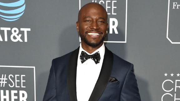 Awards host Taye Diggs arrived in a dapper tuxedo.