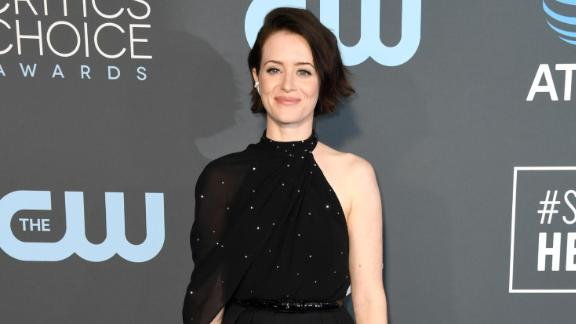 Claire Foy attends the 24th annual Critics' Choice Awards in a semi-sheer one-shoulder top and trousers.