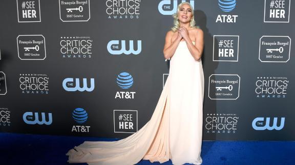 Lady Gaga wore a strapless pale peach Calvin Klein gown with a short train.
