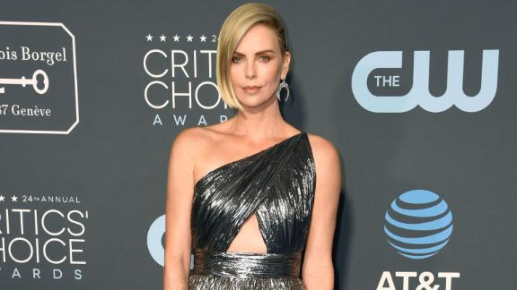 Charlize Theron wore a metallic one-shoulder Givenchy dress featuring a two-toned skirt.