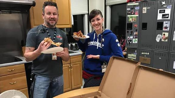 David Heady and Julie Lytle, air traffic controllers in Portland, Maine, were treated to pizza by Canadian air traffic controllers.