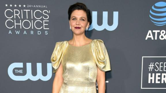 Maggie Gyllenhaal chose a more classic look with this floor-length golden gown.