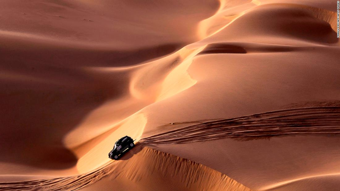 Mini's Spanish driver Nani Roma and co-driver Alexandre Haro Bravo navigate sand and dunes on stage nine.