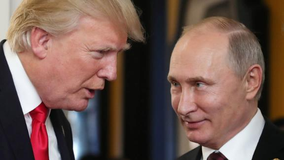 US President Donald Trump (L) chats with Russia