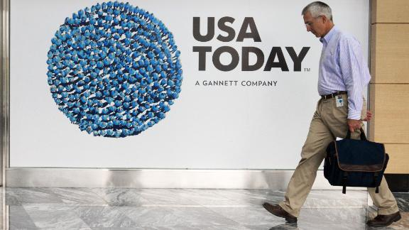A man walks through the lobby of the Gannett-USA Today headquarters in McLean, Virginia, on August 20, 2013.