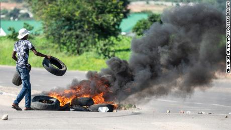Protesters burned tires in Bulawayo on Monday.