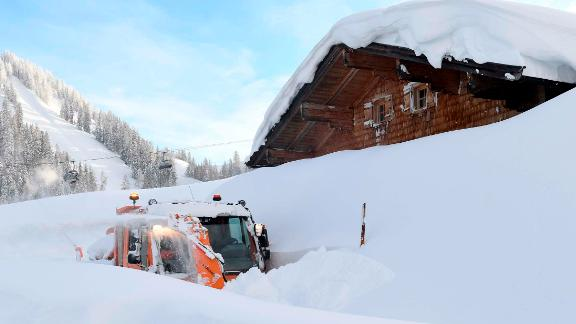 A snow blower attempts to clear a path in Lofer, Austria.