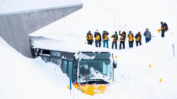 Search and rescue workers dig out a bus caught by an avalanche in Hundwil, Switzerland.