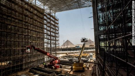A picture taken on June 10, 2018 shows a view of construction work undergoing at the site of the Grand Egyptian Museum in Giza on the southwestern outskirts of the capital Cairo, with the Pyramids of Menkaure (L) and Khafre (R), also known as Chephren, seen in the background. (Photo by Khaled DESOUKI / AFP)        (Photo credit should read KHALED DESOUKI/AFP/Getty Images)