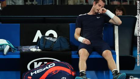 Murray reacts after losing his first round match against Roberto Bautista Agut in Melbourne