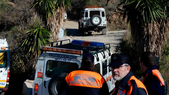 Emergency services look for a 2 year old boy who fell into a well, in a mountainous area near the town of Totalan in Malaga, Spain, Monday, Jan. 14, 2019.