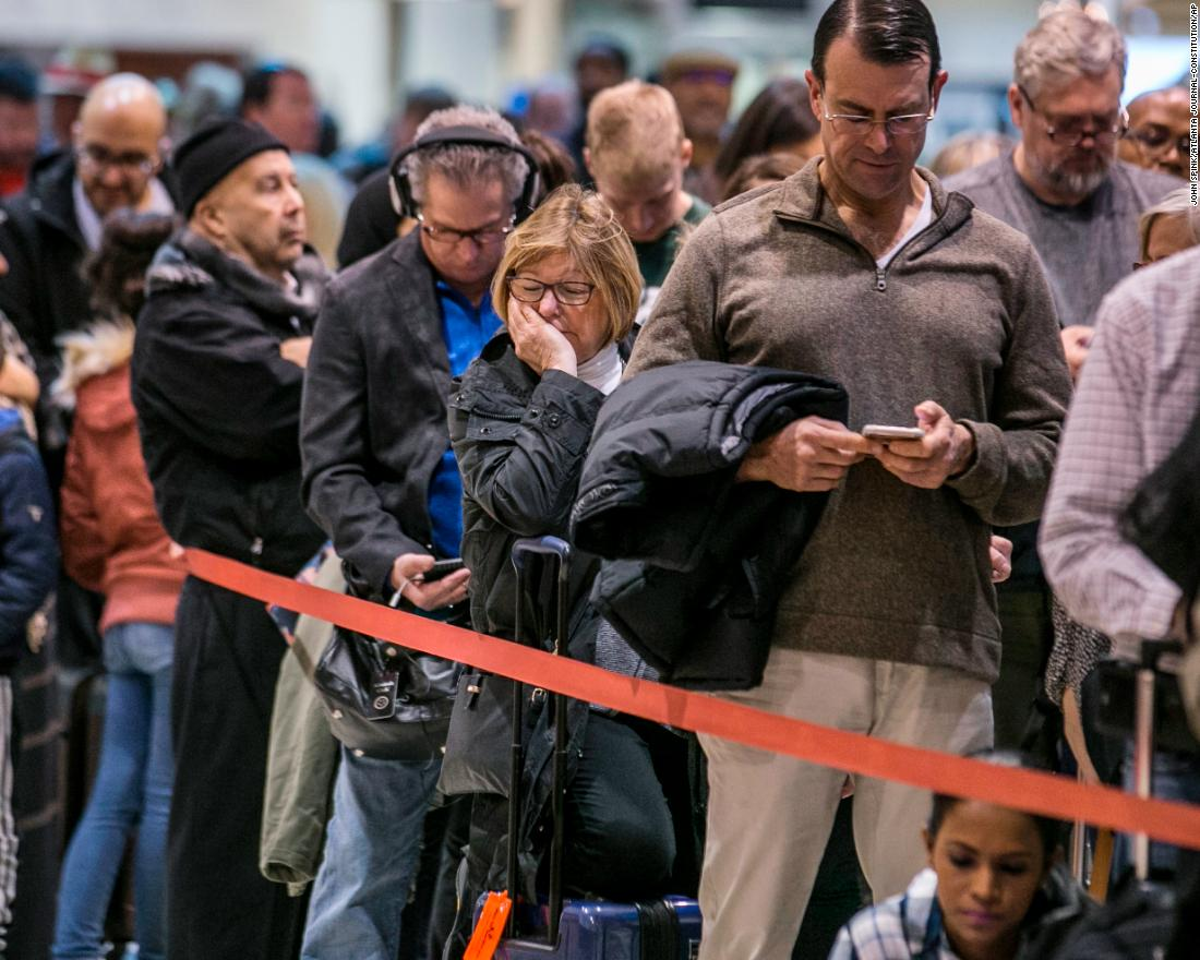 Security lines at Atlanta's Hartsfield-Jackson International Airport back up Monday, January 14, causing some travelers to miss their flights. Officers with the Transportation Security Administration had been working without pay.