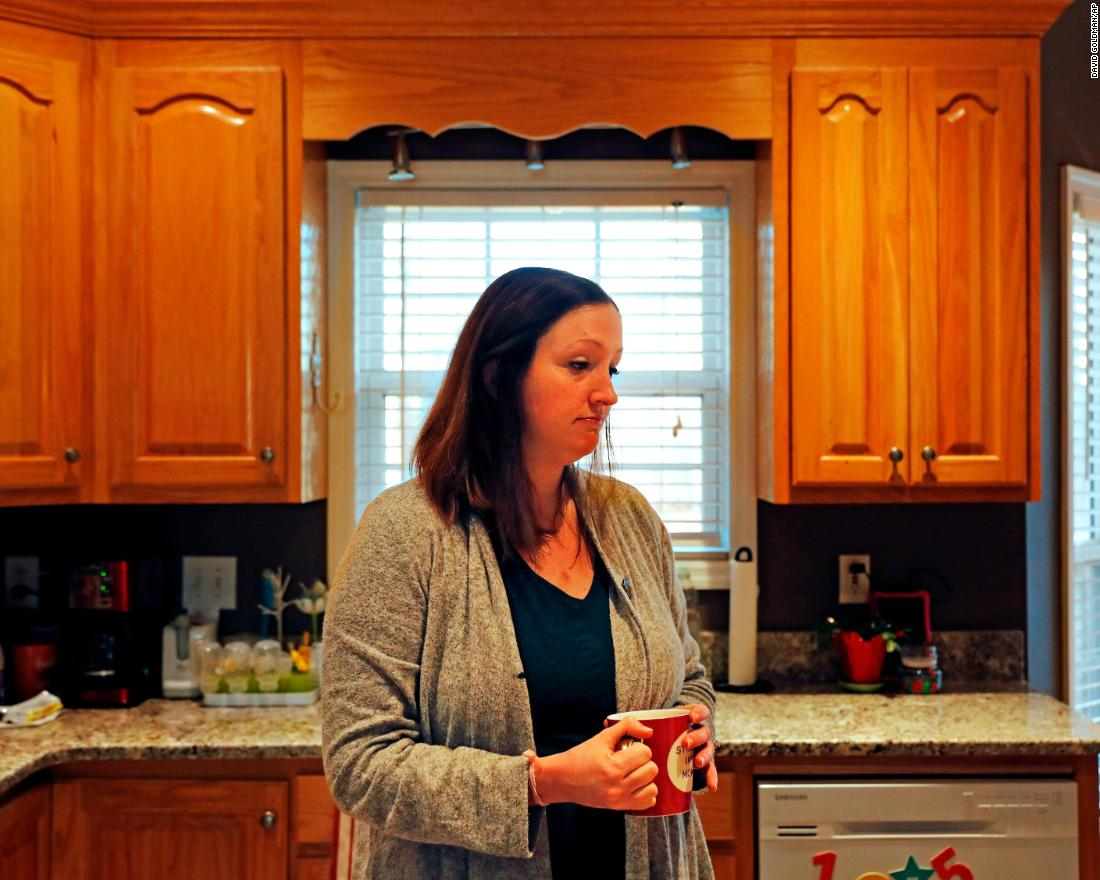 Katie Barron stands in her kitchen while working from home in Madison, Alabama, on Wednesday, January 9. Barron works for a private company not connected to the government, but her husband is a National Weather Service meteorologist who was forced to work without pay because his job is classified as essential.