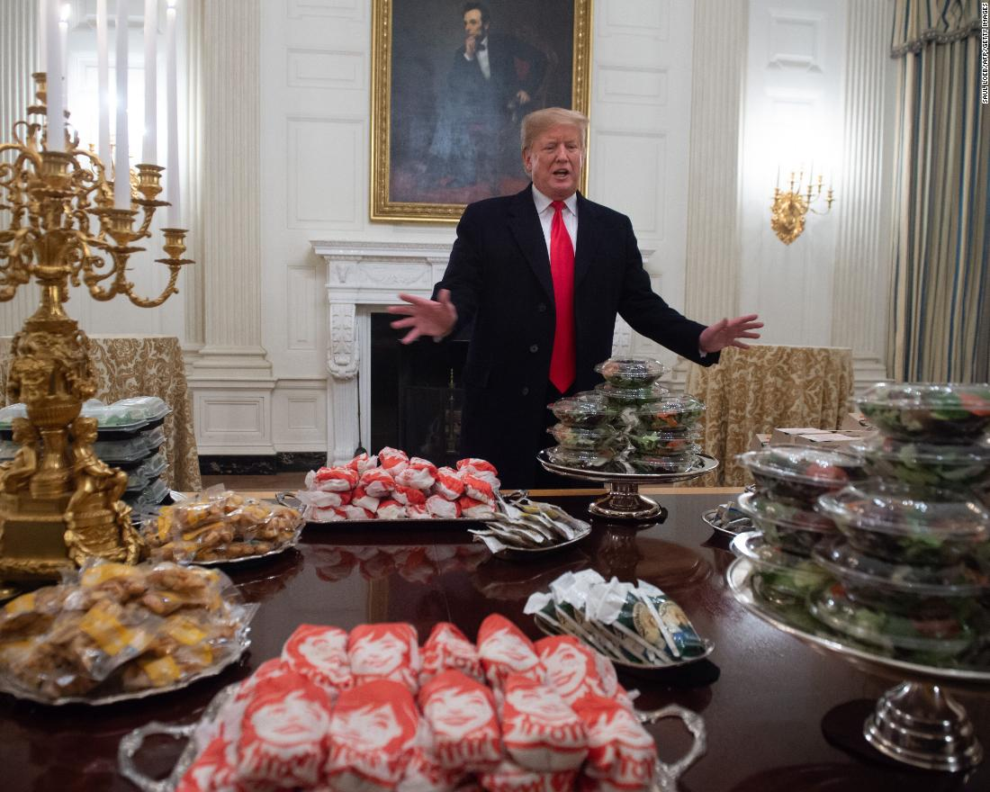 "Trump displays <a href=""https://www.cnn.com/2019/01/14/politics/donald-trump-clemson-food/index.html"" target=""_blank"">fast food </a>for Clemson University's football team to celebrate its national championship at the White House on January 14. The administration said Trump paid for the meal after much of the White House residence staff, including chefs, were furloughed."