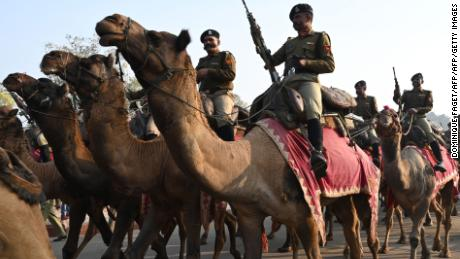 Camel-mounted soldiers march during a rehearsal for an upcoming Republic Day parade. The head of the Army says that military personnel have been warned against falling for fake social media accounts that may look to extract sensitive military information.