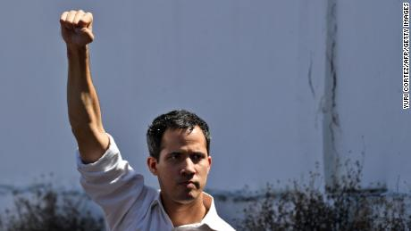Venezuela's National Assembly president Juan Guaido gestures before a crowd of opposition supporters during an open meeting in Caraballeda, Vargas State, Venezuela, on January 13, 2019.