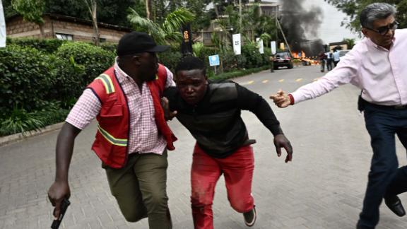 An injured man is evacuated from the scene of an explosion at a hotel complex in Nairobi's Westlands suburb on January 15, 2019, in Kenya. - A gunfight was underway following the blast in the leafy Nairobi neighbourhood, an AFP reporter and a witness said. It was not immediately clear whether the incident was a robbery or an attack. (Photo by SIMON MAINA / AFP)        (Photo credit should read SIMON MAINA/AFP/Getty Images)