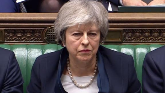Theresa May listens to opposition leader Jeremy Corbyn in the Brexit debate