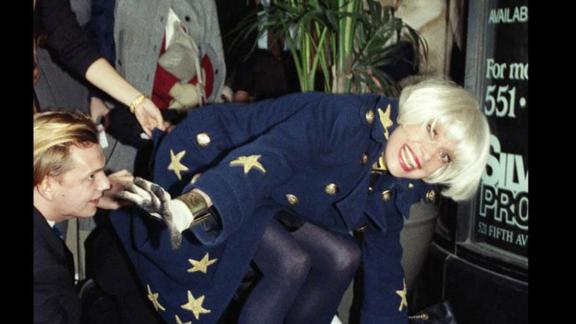 Channing places her feet in wet cement in front of the Embassy Suites Hotel in New York in November 1990 as part of an unveiling ceremony at the hotel.
