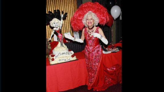"Channing dons a ""Hello, Dolly!"" costume during her 90th birthday celebration in Hollywood in February 2011."