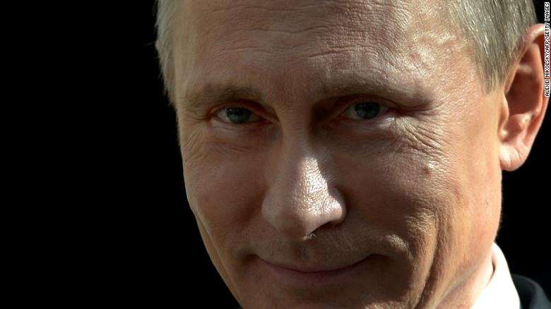 Russia's President Vladimir Putin smiles as he speaks with journalists after his annual televised question-and-answer session with the nation at Gostiny Dvor (Merchant Yard) exhibition hall in Moscow, on April 17, 2014. Putin exuded yesterday self-confidence as he fielded four hours of questions in his traditional phone-in marathon, keeping open Russia's diplomatic and military options on the Ukraine crisis. AFP PHOTO/ RIA-NOVOSTI/ POOL / ALEXEI NIKOLSKY / AFP / RIA-NOVOSTI / ALEXEI NIKOLSKY (Photo credit should read ALEXEI NIKOLSKY/AFP/Getty Images)