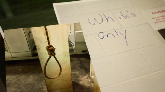 """A noose that was found hanging in the plant and graffiti marking the bathroom """"White's Only."""""""