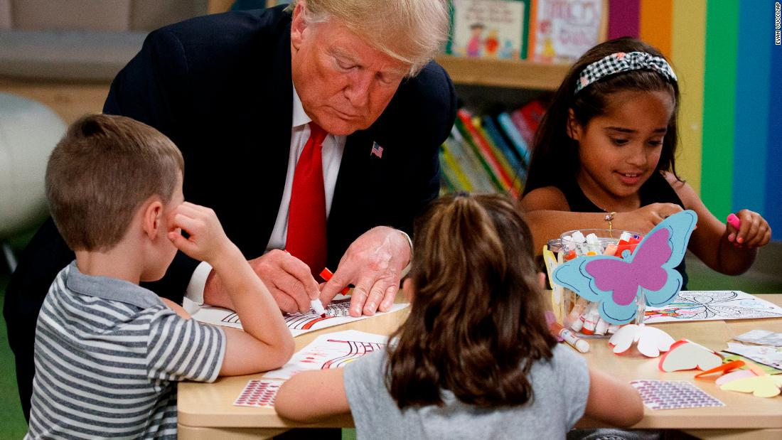 Trump colors with a group of children during a visit to the Nationwide Children's Hospital in Columbus, Ohio, on August 24.