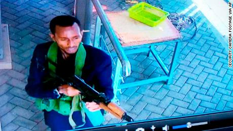 One of the armed attackers is seen on security camera footage in the hotel compound on Tuesday.