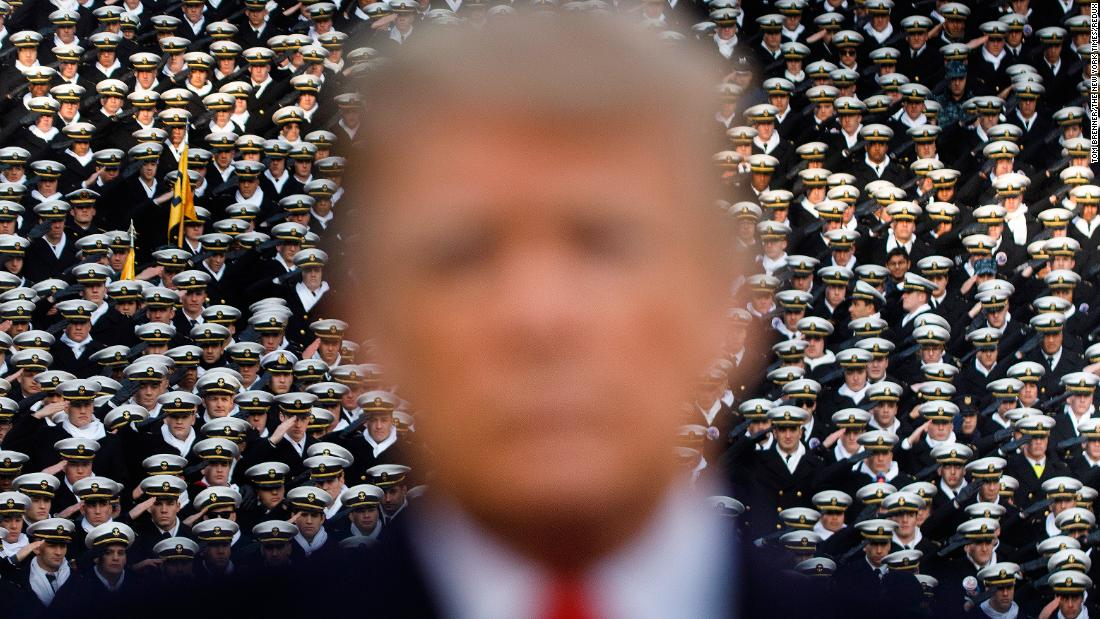 "President Trump <a href=""https://www.cnn.com/2018/12/08/politics/army-navy-president-donald-trump/index.html"" target=""_blank"">attends the Army-Navy football game</a> in Philadelphia on December 8. Photographer Tom Brenner said, ""This was a last-second creative moment from a handshake photo opportunity between Trump and Defense Secretary General Jim Mattis."""