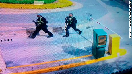 Heavily armed attackers walk through the Nairobi hotel compound in this grab taken from security camera footage released to the local media.