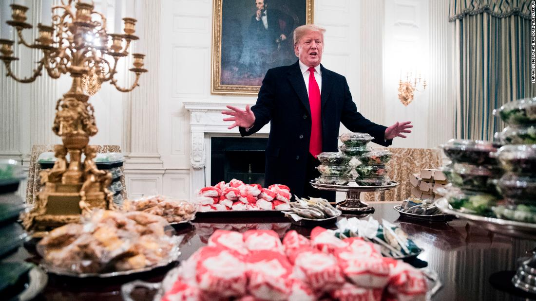 "The President displays <a href=""https://www.cnn.com/2019/01/14/politics/donald-trump-clemson-food/index.html"" target=""_blank"">fast food he purchased</a> for the Clemson Tigers football team for their national championship celebration at the White House on January 14. ""Because the Democrats refuse to negotiate on border security, much of the residence staff at the White House is furloughed -- so the President is personally paying for the event to be catered with some of everyone's favorite fast foods,"" deputy press secretary Hogan Gidley told CNN in a statement"